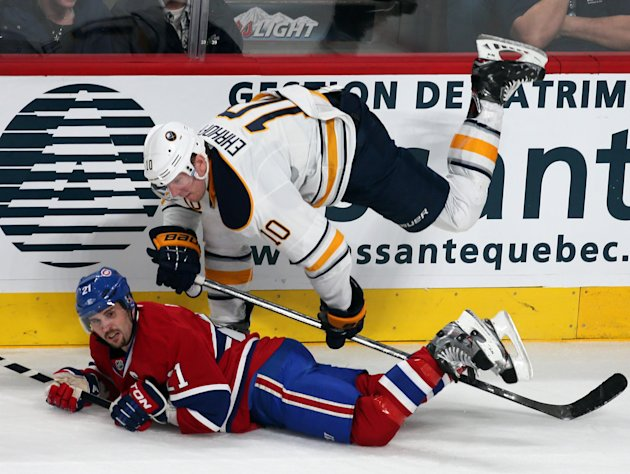 Montreal Canadiens Brian Gionta is upended by Buffalo Sabres Christian Ehrhoff during first period NHL hockey action in Montreal