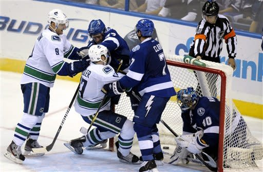 Raymond scores in SO, Canucks top Lightning 5-4