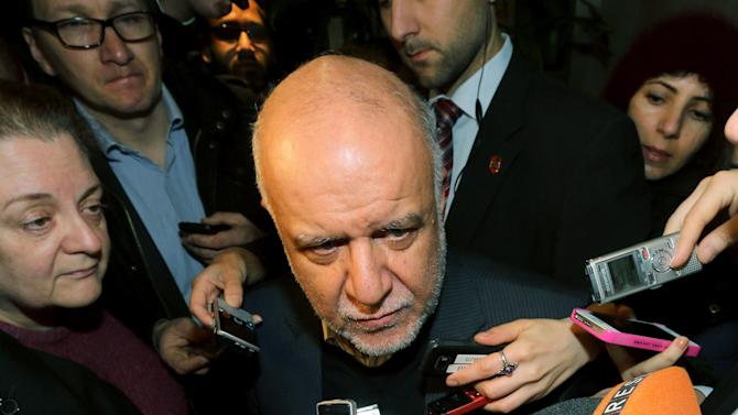 Iran's Minister of Petroleum Bijan Namdar Zangeneh talks to journalists as he arrives at a hotel for a meeting of the Organization of the Petroleum Exporting Countries, OPEC, in Vienna, Austria, Wednesday, Nov. 26, 2014. (AP Photo/Ronald Zak)