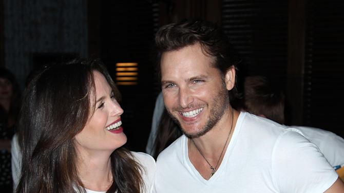 "Actress Elizabeth Reaser, left, and actor Peter Facinelli pose together at Summit Entertainment's ""The Twilight Saga: Breaking Dawn - Part 2"" VIP Comic-Con celebration, Wednesday, July 11, 2012, in San Diego. (Photo by Matt Sayles/Invision/AP)"