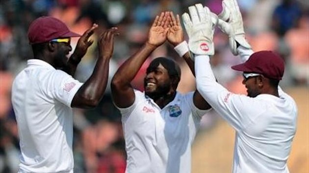 Tino Best celebrates with West Indies captain Darren Sammy and Denesh Ramdin after the dismissal of Bangladesh batsman Shahriar Nafees (AFP)
