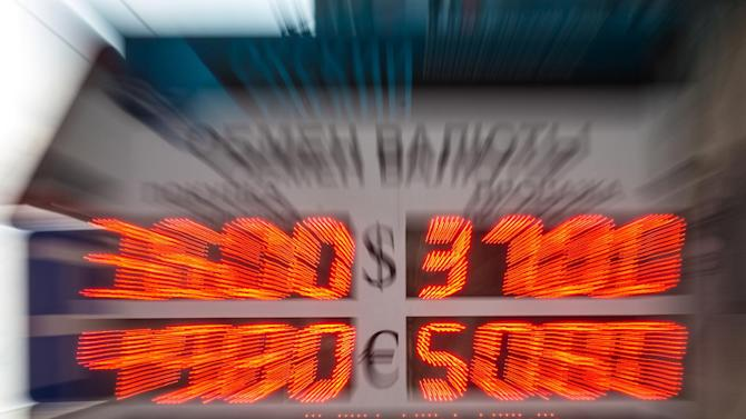 The ruble fell to 37.57 against the dollar at about 1135 GMT