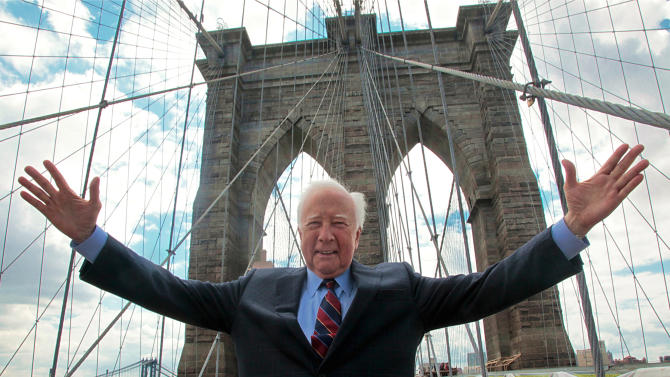 """In this May 10, 2012 photo, author David McCullough, two-time Pulitzer Prize winner for books """"Truman"""" and """"John Adams,"""" gestures as he walks over the Brooklyn Bridge in New York. McCullough is celebrating the 40th anniversary of his book """"The Great Bridge,"""" which has just been reissued with a new introduction by the 78-year-old writer. (AP Photo/Bebeto Matthews)"""