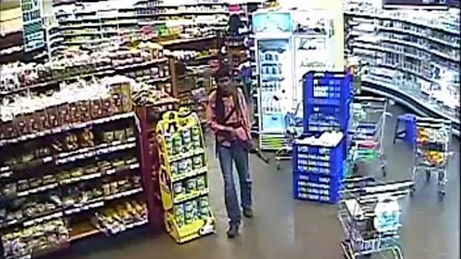 In this photo taken from footage from Citizen TV, via the Kenya Defence Forces and made available Friday, Oct. 4 2013, a man reported to be Umayr, one of the four armed militants walking in a store at the Westgate Mall, during the four-day-long siege at the Westgate Mall in Nairobi, Kenya which killed more than 60 people last month. A Kenyan military spokesman has confirmed the names of four attackers as Abu Baara al-Sudani, Omar Nabhan, Khattab al-Kene and Umayr. (AP Photo/ Kenyan Defence forces via Citizen TV)