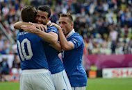 Italian forward Antonio Di Natale (C) celebrates with teammates after scoring during the Euro 2012 championships football match Spain vs Italy at the Gdansk Arena. The match ended in a 1-1 draw