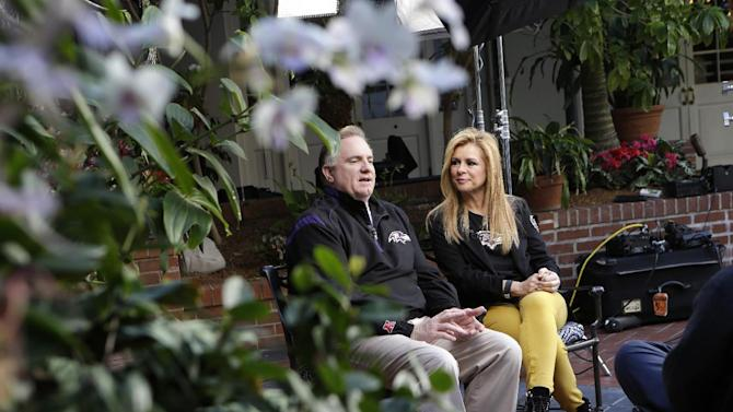 """In this Friday, Feb. 1, 2013 photo, Sean and Leigh Anne Tuohy, adoptive parents of Baltimore Ravens starting offensive lineman Michael Oher, take part in a television interview in New Orleans. They were depicted in the move """"The Blind Side"""" and will be attending Sunday's NFL football Super Bowl between the Ravens and the San Francisco 49ers. (AP Photo/Gerald Herbert)"""