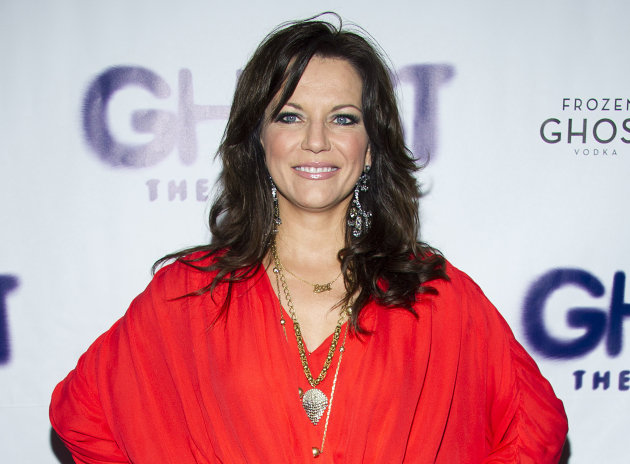"FILE - This April 23, 2012 file photo shows country singer Martina McBride at the opening night of the Broadway show ""Ghost The Musical"" in New York. McBride will appear on ""Good Morning America"" in support of her friend Robin Roberts. McBride will visit with the ""GMA"" host and sing her Grammy-nominated song ""I'm Gonna Love You Through It"" on Thursday, Aug. 30. Roberts, who announced earlier this week that she will be taking medical leave for a bone marrow transplant and treatment for MDS, appeared in the music video for the inspirational song about going through cancer. (AP Photo/Charles Sykes, file)"