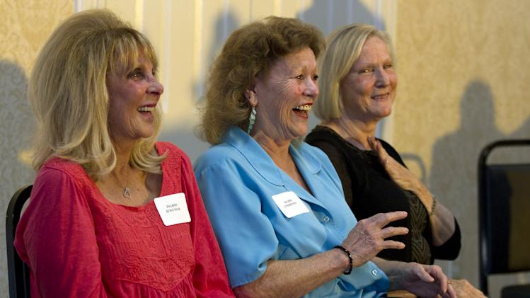 "In this Thursday, July 24, 2014 photo, from left, sisters Ingrid Jewusiak, of Point Pleasant, N.J., Sigrid Endreson, of Beachwood, N.J., and Marie McHenry, of Little Egg Harbor, N.J., who will share a $20 million lottery jackpot with their 14 siblings, enjoy a light moment during a news conference, in Beachwood. The large New Jersey shore family that suffered losses during Superstorm Sandy will share the New Jersey Pick-6 prize that Endreson, who bought the winning ticket, said would be ""a great pick-me-up."" (AP Photo/The Asbury Park Press, Doug Hood) NO SALES"