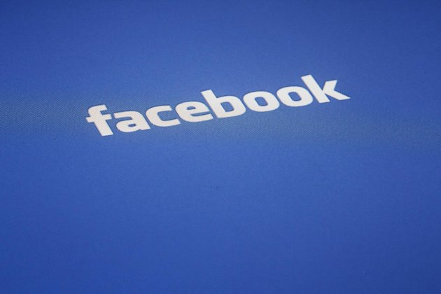 A Facebook logo is displayed on the screen of an iPad, Wednesday, May 16, 2012 in New York. Facebook&#39;s initial public offering is one of the most hotly anticipated in years. The company is likely to have an estimated market valuation of $100 billion when its shares begin trading on the Nasdaq stock market on Friday. (AP Photo/James H. Collins)
