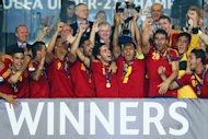 JERUSALEM, ISRAEL - JUNE 18: Captain Thiago Alcantara of Spain lifts the trophy after winning the UEFA European U21 Championship final match against Italy at Teddy Stadium on June 18, 2013 in Jerusalem, Israel.  (Photo by Alex Grimm/Getty Images)