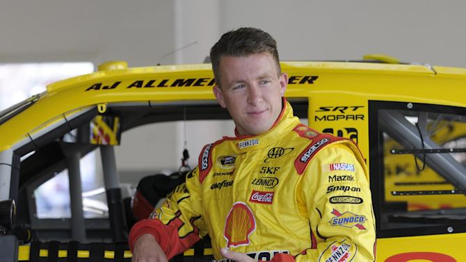 In this Feb. 18, 2012, photo, AJ Allmendinger leans against his car in the garage area during NASCAR Daytona 500 practice at Daytona International Speedway in Daytona Beach, Fla. NASCAR has temporarily suspended Allmendinger after he failed a drug test. Allmendinger won't be allowed to drive Saturday night, July 7, in the Sprint Cup race at Daytona. Instead, Sam Hornish Jr. will be behind the wheel of the No. 22 Dodge for Penske Racing. Allmendinger has 72 hours to request that his B sample be tested. (AP Photo/Phelan M. Ebenhack)