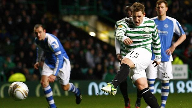 Celtic's Kris Commons (R) scores his second goal with a penalty kick against St Johnstone during their Scottish League Cup match at Celtic Park stadium in Glasgow, Scotland October 30, 2012.