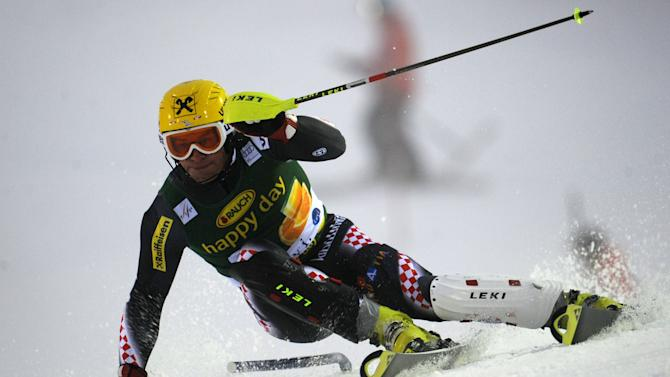 Croatia's Ivica Kostelic slaloms past a pole on his way to clock the 9th fastest time during the first run of an alpine ski, men's World Cup slalom, in Levi, Finland, Sunday, Nov. 11 , 2012. (AP Photo/Giovanni Auletta)