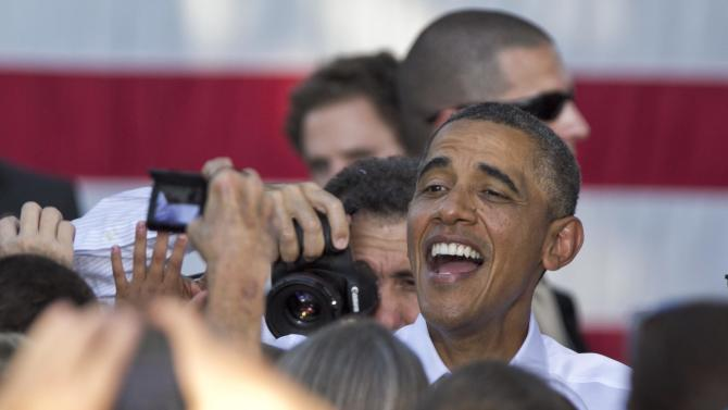President Barack Obama greets supporters following a campaign stop in Sioux City, Iowa, Saturday, Sept. 1, 2012. (AP Photo/Nati Harnik)