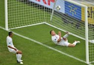 English defender John Terry (R) clears the ball during the Euro 2012 football championships match England vs Ukraine at the Donbass Arena in Donetsk. England scraped into the quarter-finals of Euro 2012 here Tuesday after a goal-line refereeing blunder helped them to a 1-0 win over Ukraine which sent the co-hosts crashing out