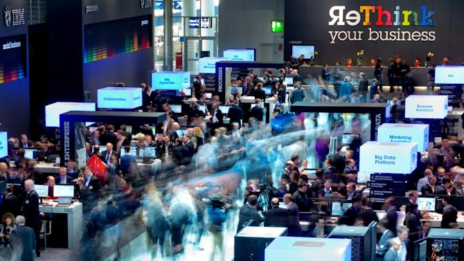 In this March 5, 2013, photo, made with a long exposure, visitors walk through the booths of IBM at the world's largest computer expo CeBIT in Hanover,Germany. Union Pacific Corp. reports quarterly financial results before the market opens Thursday, April 18, 2013. (AP Photo/dpa, Julian Stratenschulte)