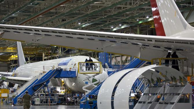 News media groups tour the assembly line of the Boeing Co. 787 in Everett, Wash. on Sunday, Sept. 25, 2011. All Nippon Airways is the first customer to take delivery of the 787. (AP Photo/John Froschauer)