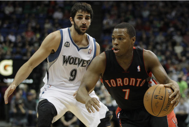 Toronto Raptors guard Kyle Lowry (7) drives the ball around Minnesota Timberwolves guard Ricky Rubio (9) in the first half of an NBA basketball game, Sunday, March 9, 2014, in Minneapolis. The Raptors