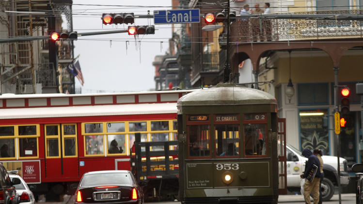 "FILE- In this Jan. 25, 2011 file photo, streetcars move throughdowntown New Orleans. With the Super Bowl in New Orleans Feb. 3 and Mardi Gras falling just nine days later, the city is gearing up for a massive celebration and influx of tourists that locals are calling ""Super Gras.""  (AP Photo/Gerald Herbert, file)"