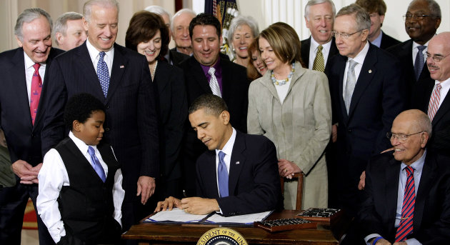 FILE - In this March 23, 2010 file photo President Barack Obama signs the health care bill in the East Room of the White House in Washington. He is flanked by Marcelas Owens of Seattle, left, and Rep. John Dingell, D-Mich. Behind, from left are, Sen. Tom Harkin, D-Iowa., Senate Majority Whip Richard Durbin of Ill., Vice President Joe Biden, Vicki Kennedy, widow of Sen. Ted Kennedy, Sen. Christopher Dodd, D-Conn., Rep. Sander Levin, D-Mich., Ryan Smith of Turlock, Calif., Health and Human Services Secretary Kathleen Sebelius, House Speaker Nancy Pelosi of Calif., House Majority Leader Steny Hoyer of Md., Senate Majority Leader Harry Reid of Nev., Rep. Patrick Kennedy, D-R.I., House Majority Whip James Clyburn of S.C., and Rep. Henry Waxman, D-Calif. The Supreme Court said Monday it will hear arguments in March over President Barack Obamas health care overhaul, setting up an election-year showdown over the White House&#39;s main domestic policy achievement. (AP Photo/J. Scott Applewhite, File)