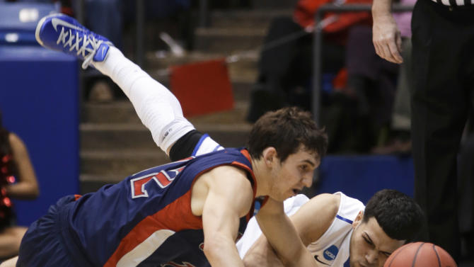 St. Mary's guard Jordan Giusti (12) chases a loose ball against Middle Tennessee guard Raymond Cintron in the first half of a first-round game of the NCAA men's college basketball tournament, Tuesday, March 19, 2013, in Dayton, Ohio. (AP Photo/Al Behrman)