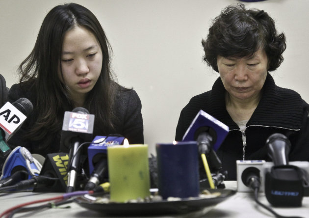 Ashley Han, 20,  sits next to her mother Serim Han, as she talks about her father Ki-Suck Han during a news conference on Wednesday, Dec. 5, 2012 in New York.  Naeem Davis, 30, was taken into custody