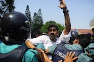 Members of parliament from the Bangladesh Nationalist Party clash with riot police during a nationwide strike in Dhaka on Sunday. Rights groups have blamed security agencies for the disappearance of dozens of opposition activists over the past two years, alleging the victims have been abducted on government orders