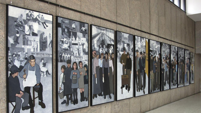An 11-panel mural depicting the state's labor history is on public display in the atrium leading to the Maine State Museum on Monday, Jan. 14, 2013, in Augusta, Maine.  Gov. Paul LePage ordered the panel removed from the Labor Department lobby in March 2011. (AP Photo/Clarke Canfield)