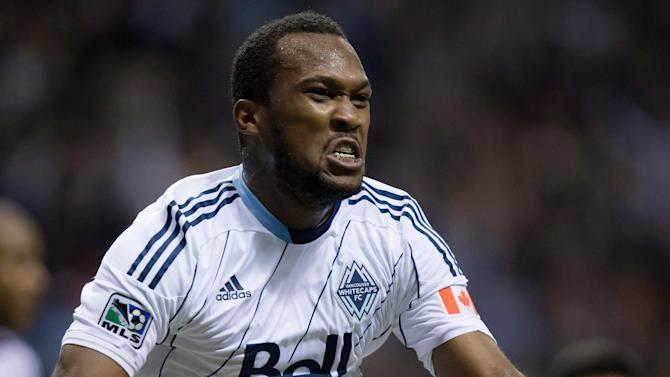 Vancouver Whitecaps' Kendall Watson celebrates after scoring a goal against the Colorado Rapids during the second half of an MLS soccer game Saturday, Oct. 25, 2014, in Vancouver, British Columbia. (AP Photo/The Canadian Press, Darry Dyck)