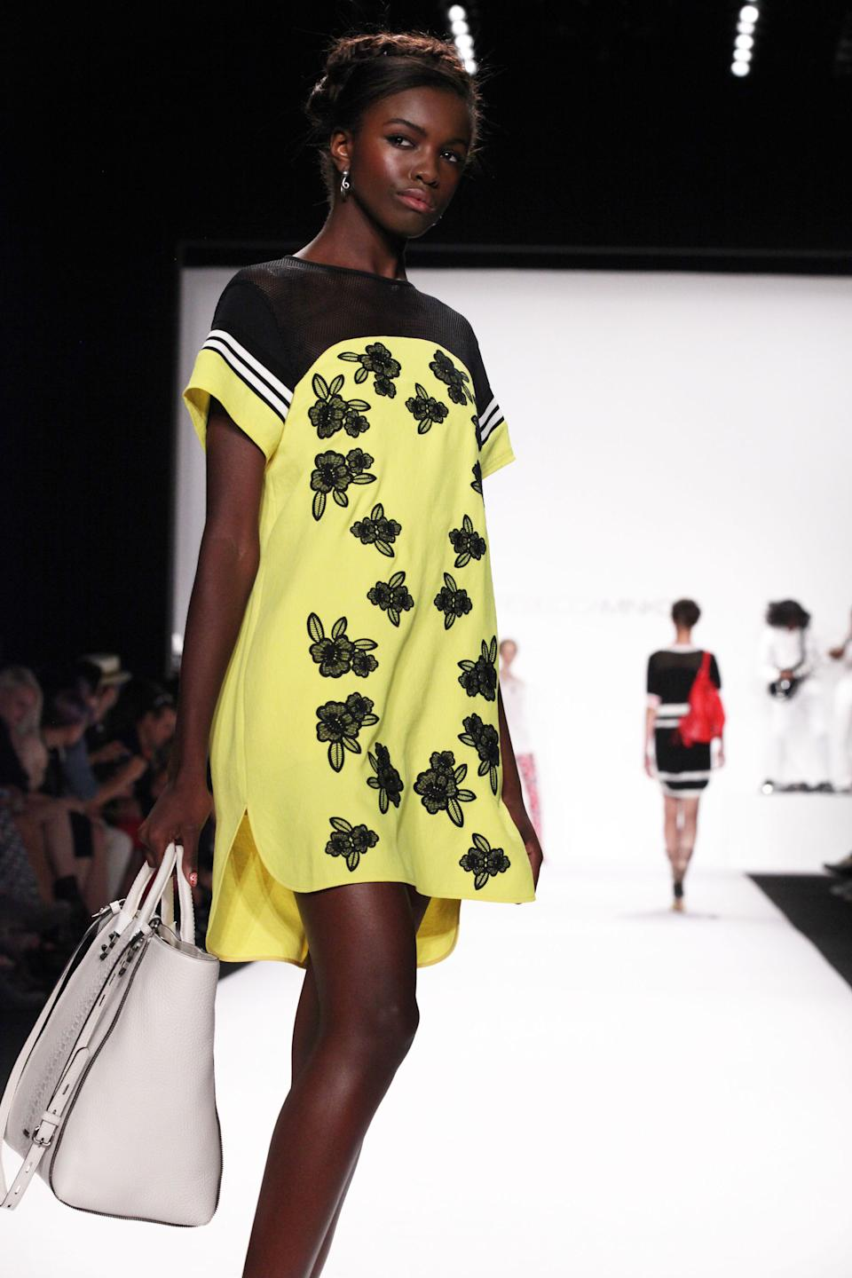 The Rebecca Minkoff Spring Summer 2014 collection is modeled at New York Fashion Week on Friday, Sept. 6, 2013 in New York. (AP Photo/Lisa Tolin)