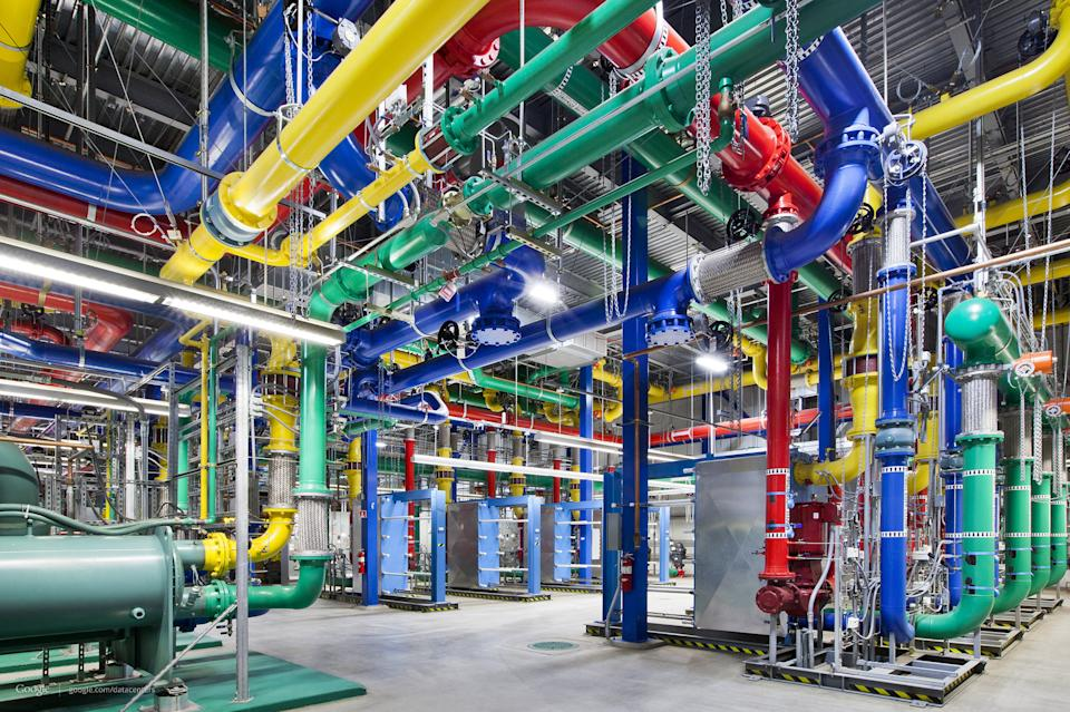 This undated photo made available by Google shows colorful pipes sending and receiving water for cooling Google's data center in The Dalles, Ore. The blue pipes supply cold water and the red pipes return the warm water back to be cooled. (AP Photo/Google, Connie Zhou)