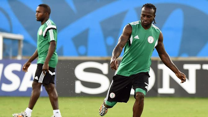 Nigeria winger Victor Moses (R) kicks a ball during a training session at the Pantanal Arena in Cuiaba, Brazil on June 20, 2014