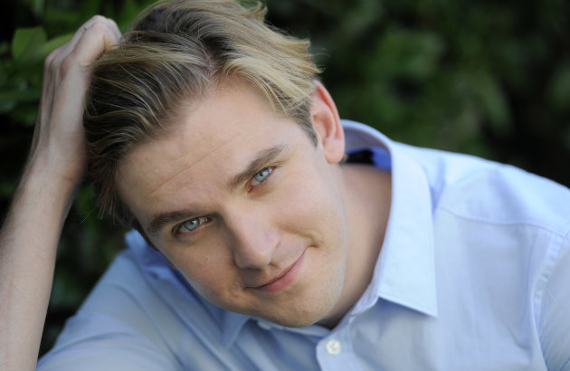 "FILE - In this July 31, 2011 file photo, actor Dan Stevens poses for a portrait, in Beverly Hills, California. The ""Downton Abbey"" star has had a double-dose of drama this month. The British actor, who plays Matthew Crawley, has been shooting the third series of the Golden Globe-winning country house TV series set in 1920 - and another period piece at the same time. (AP Photo/Chris Pizzello, File)"
