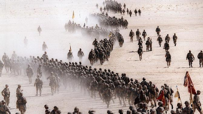 FILE - Responding to Iraq's invasion of Kuwait, troops of the U.S. 1st Cavalry Division deploy across the Saudi desert on Nov. 4, 1990 during preparations prior to the Gulf War. (AP Photo/Greg English, File)