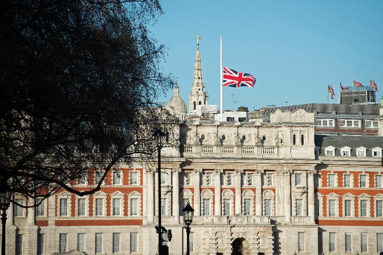 UK decision to lower flags after death of Saudi king stirs debate