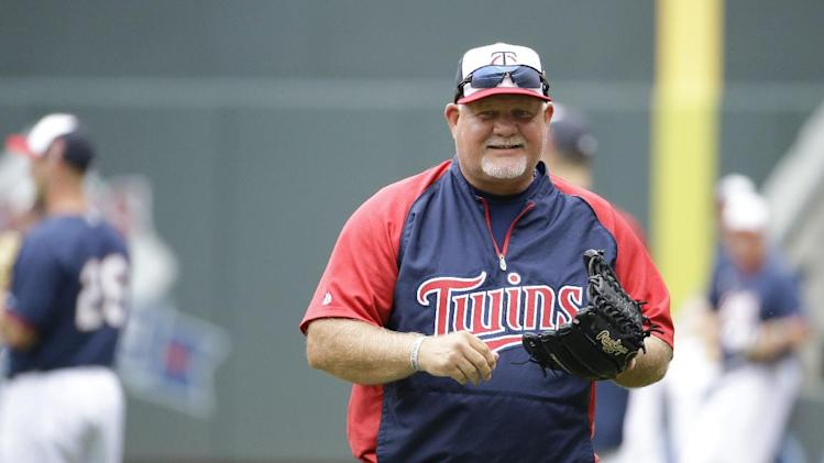 Minnesota Twins manager Ron Gardenhire smiles at a teammate before a baseball game against the Chicago White Sox in Minneapolis, Friday, July 25, 2014. (AP Photo/Ann Heisenfelt)