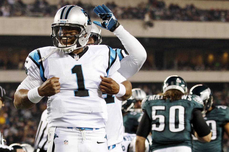 Carolina Panthers quarterback Cam Newton (1) reacts after scoring a touchdown in the second half of an NFL football game against the Philadelphia Eagles, Monday, Nov. 26, 2012, in Philadelphia. (AP Photo/Mel Evans)