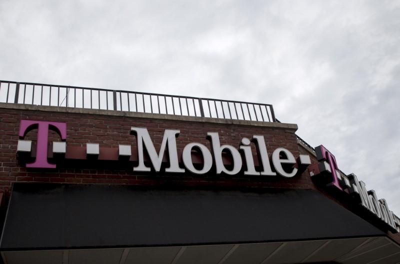T-Mobile raises forecast; sees 'upside' from AT&T-Time Warner deal
