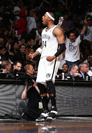 Nets cool Heat, cut East semifinal deficit to 2-1