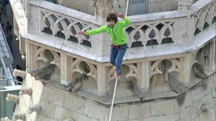 Man walks tightrope at Austria cathedral