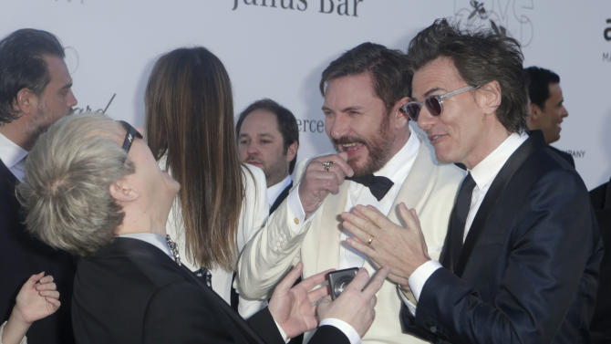 From left, Nick Rhodes, Simon Le Bon and John Taylor from Duran Duran share a joke as they arrive at amfAR Cinema Against AIDS benefit at the Hotel du Cap-Eden-Roc, during the 66th international film festival, in Cap d'Antibes, southern France, Thursday, May 23, 2013. (Photo by Joel Ryan/Invision/AP)