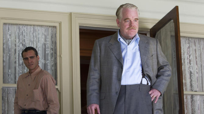 "FILE - This undated file handout film image released by The Weinstein Company shows Joaquin Phoenix, left, and Philip Seymour Hoffman in a scene from ""The Master."" On Sunday, Dec. 9, 2012, the Los Angeles Film Critics Association announced their picks for movies of 2012.  The French old-age drama ""Amour"" was chosen as the year's best film.  The 1950s cult drama ""The Master"" earned three awards: best director for Paul Thomas Anderson, best actor for Joaquin Phoenix and supporting actress for Amy Adams.  ""The Master"" also was chosen as best-picture runner-up.  ""Amour"" star Emmanuelle Riva shared the best-actress honor in a tie with Jennifer Lawrence for the lost-soul romance ""Silver Linings Playbook."" Newcomer Dwight Henry was chosen as supporting actor for the low-budget critical darling ""Beasts of the Southern Wild.""  (AP Photo/The Weinstein Company, File)"