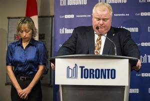 Toronto Mayor Rob Ford speaks at a news conference with his wife Renata at City Hall in Toronto