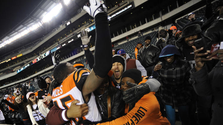 Cincinnati Bengals' Jeromy Miles celebrates in the stands after an NFL football game against the Philadelphia Eagles, Thursday, Dec. 13, 2012, in Philadelphia. Cincinnati won 34-13. (AP Photo/Michael Perez)