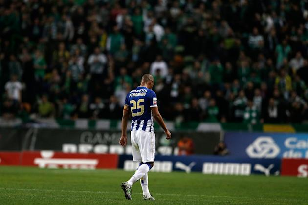 Porto's Fernando leaves the pitch after being sent off by the referee during their Portuguese league soccer match with Sporting Sunday, March 16 2014, at Sporting's Alvalade stadium in Lisbon.