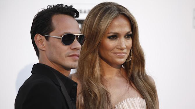 """FILE  - In a May 20, 2010 file photo, singers Mark Anthony and Jennifer Lopez arrive for the amfAR Cinema Against AIDS benefit during the 63rd Cannes international film festival, in Cap d'Antibes, southern France. The exes have announced that they'll perform together on May 26 in Las Vegas as part of """"Q'Viva! The Chosen Live,"""" which will feature the top talent from their televised talent show. (AP Photo/Matt Sayles, File)"""
