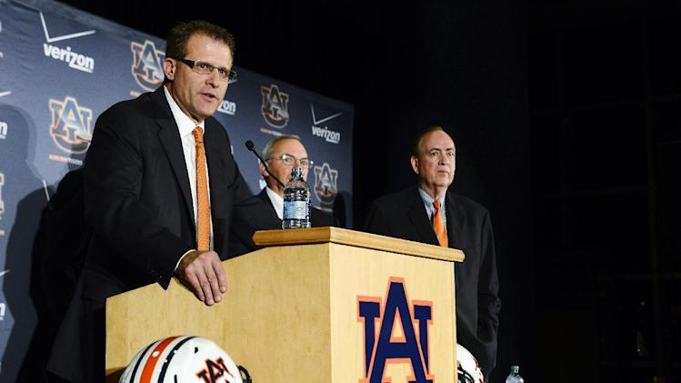 Newly hired Auburn head coach Gus Malzahn speaks during an NCAA college football news conference, Tuesday, Dec. 4, 2012, in Auburn, Ala. Malzahn received a five-year contract worth $2.3 million annually to try to get the team back on solid footing. (AP Photo/Todd J. Van Emst)