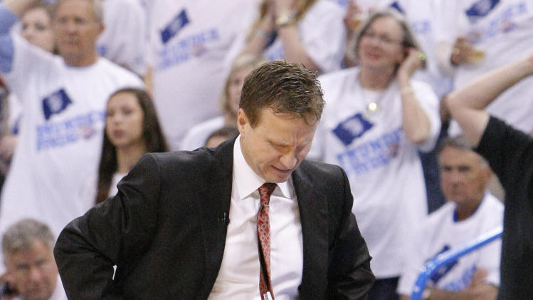 Oklahoma City Thunder head coach Scott Brooks reacts during the second half of Game 5 of their Western Conference Semifinals NBA basketball playoff series in Oklahoma City, Wednesday, May 15, 2013.  Memphis won 88-84. (AP Photo/Alonzo Adams)