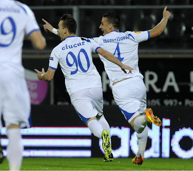 Pandurii's Marko Momcilovic, from Serbia, right, celebrates scoring against Pacos Ferreira with teammate Alexandru Ciucur during their Europa League Group E soccer match at the D. Afonso Henriques Sta