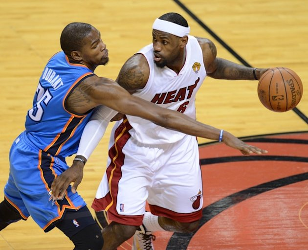LeBron James (R) Of The Miami Heat Is AFP/Getty Images